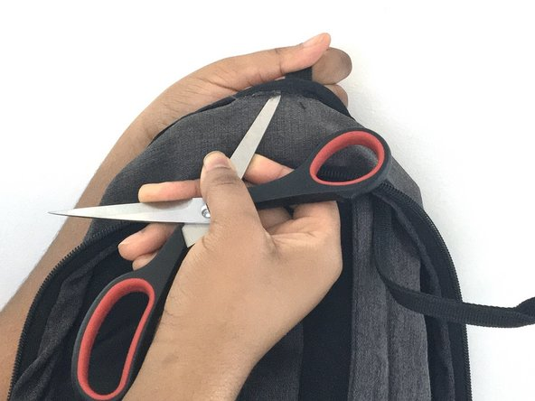 Open up the inner seam at the same spot using a pair of scissors.