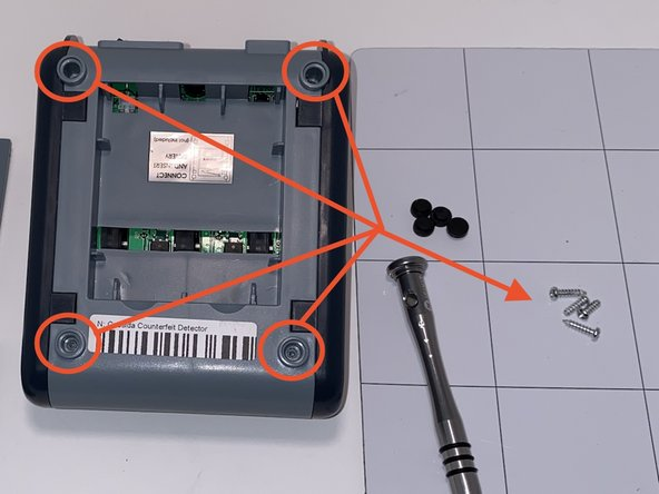 Using a Phillips #1 bit, remove the circled screws.