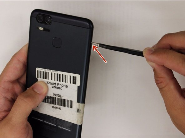 Using a pair of tweezers, pull put the SIM card tray and set it to the side.
