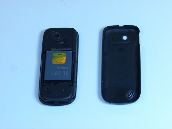 Remove the back cover to expose the battery.