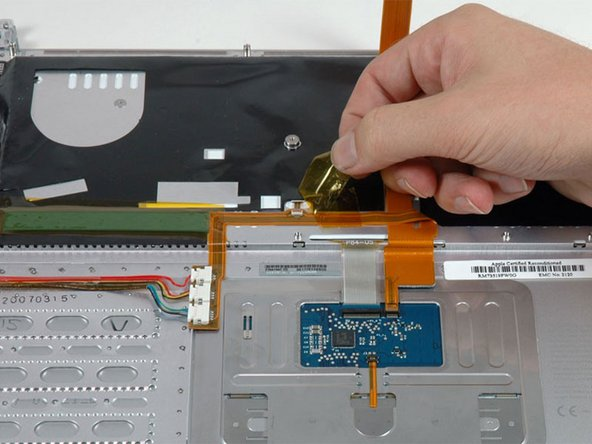 Peel up the orange tape covering the keyboard backlight connector.