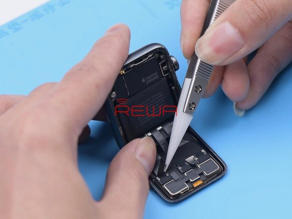 Peel off the tape covering the display flex cables with tweezers. Please do not damage the flex cables while peeling off. Then disconnect the flex cables.