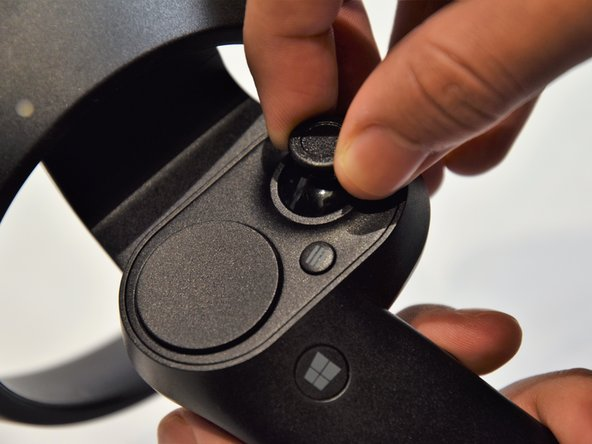Grip the main body and pull the joystick outwards until the entire front panel pops off.