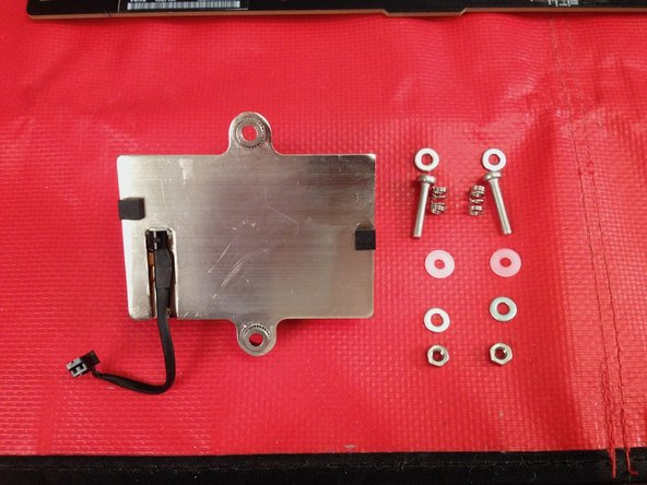 Line up the components you will use to put the northbridge heatsink back onto the PCB.