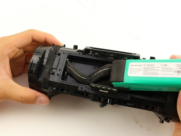 Pull the battery and battery cable out from their housing.