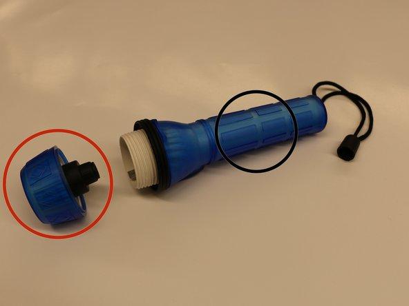 Disassembling Translucent Rubber Flashlight Battery Power Component