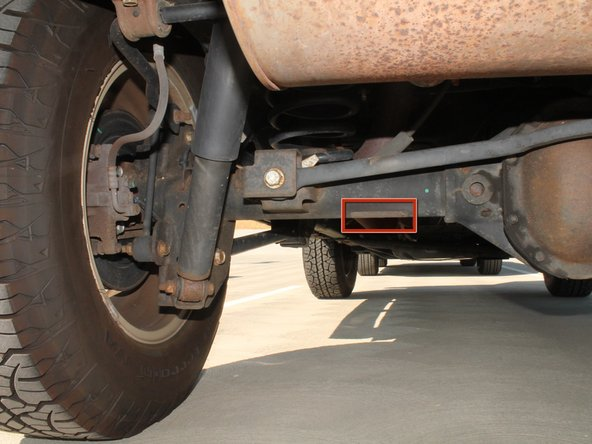 The jack will be holding up the car so that the car does not fall on you. Make sure that the vehicle is secure on the jack.  Check that your vehicle is in park and has the emergency brake/parking brake on.