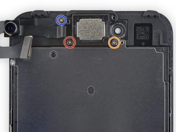 Remove the following three Phillips screws securing the earpiece speaker to the front panel: