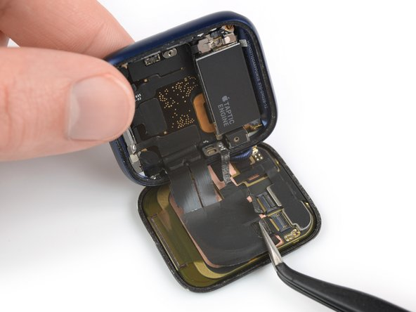 Use a pair of tweezers to pull both display cables out of the ZIF connectors.