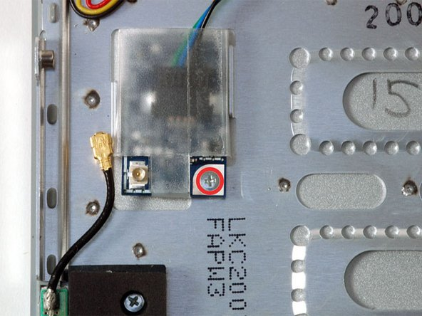 Remove the single Phillips screw securing the Bluetooth board to the lower case.
