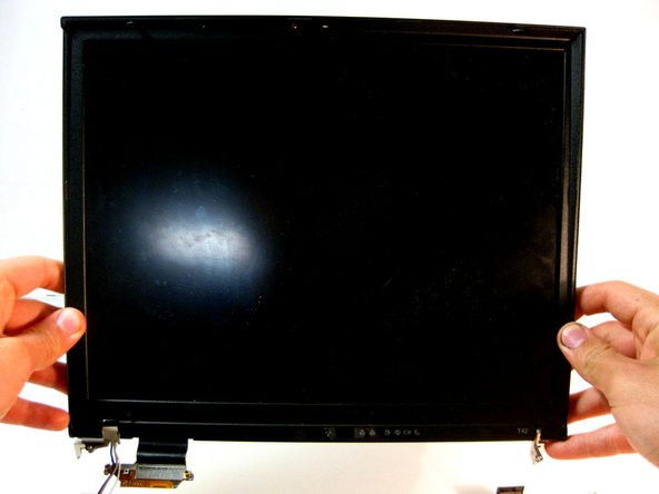 Carefully unplug the display ribbon on the motherboard, then carefully lift the display free from the device.