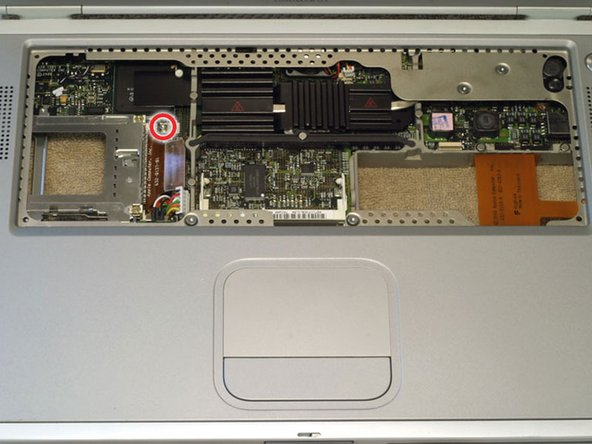 Remove the single T8 Torx screw located next to the PC Card cage.