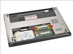 Extracción del módulo de memoria Dell Vostro V131