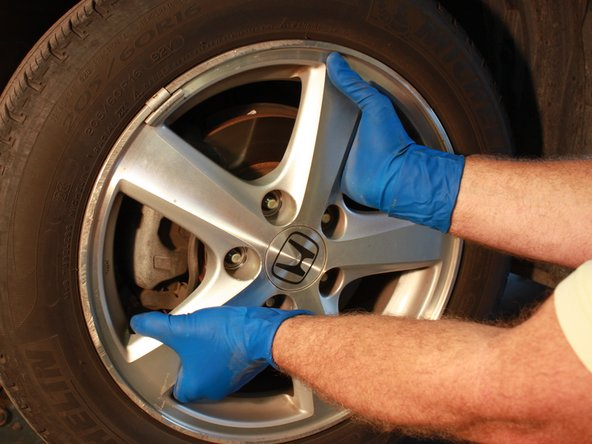 Remove the tire off the wheel studs and place it aside.