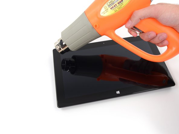 Use an iOpener or heat gun to melt the adhesive.