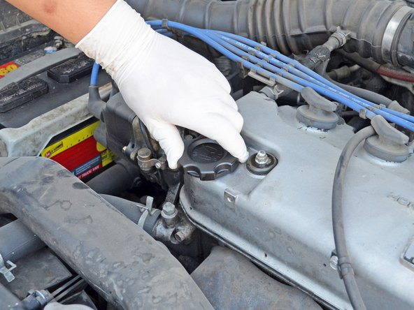 Locate the oil filler cap. It is on the front passenger side of the valve cover.