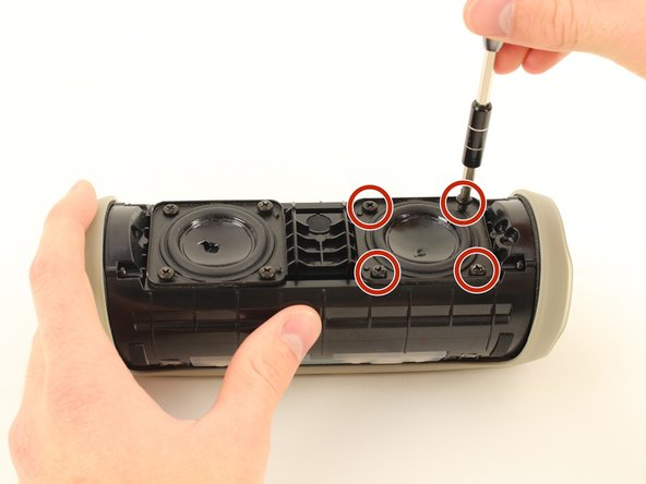 Remove all four 10 mm JIS #1 screws around the damaged front active speaker.