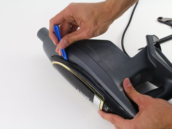 Use the iFixit opening tool to remove the top component.