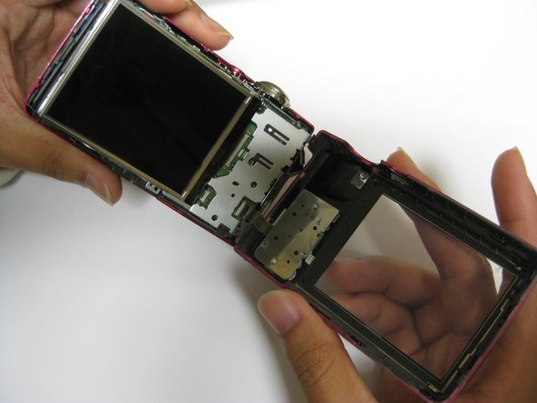 Carefully remove the back casing from the camera.