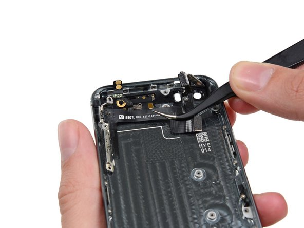 Remove the upper component assembly from the iPhone.