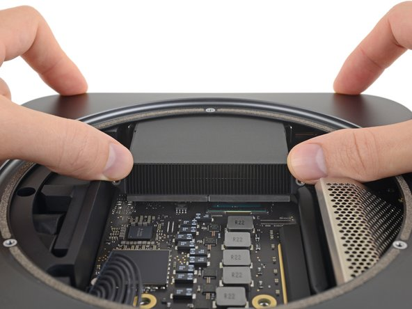 In this step, you'll push the logic board free from the clips holding it to the frame. Push only where directed or you may damage the fragile cooling fins.