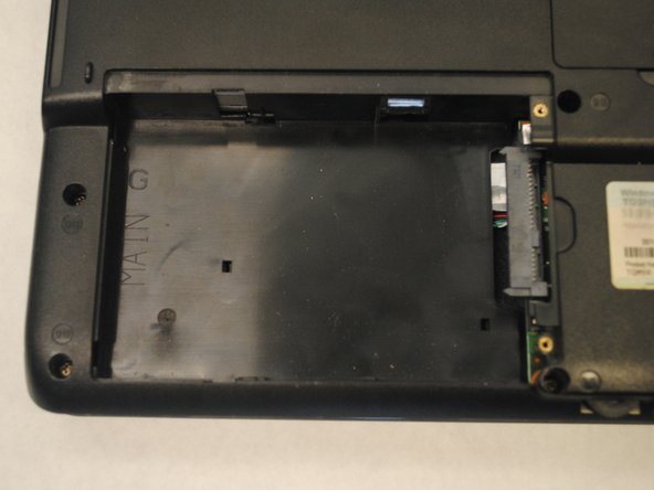 Lift the cover to reveal the old hard drive.