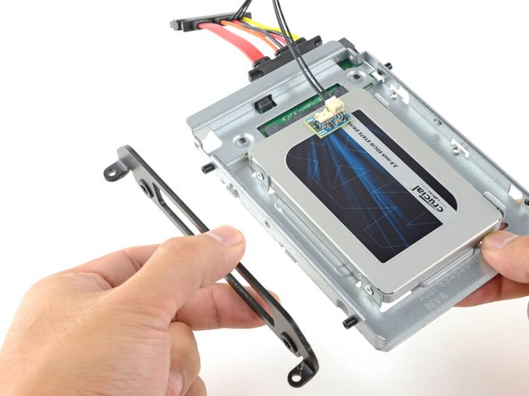 Attach any mounting brackets removed from the old hard drive onto the enclosure.