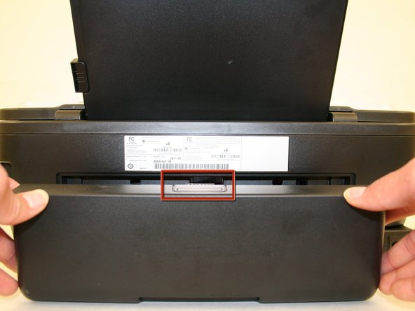 Remove the duplex unit from the back of the printer with the duplex unit facing up.