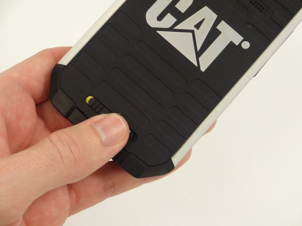 Remove the back covering by gently lifting upwards from the bottom of the back covering. The back will snap off and the battery is exposed.