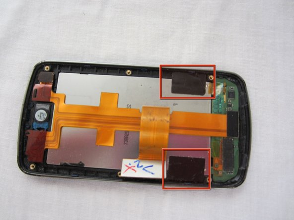 Remove the black electrical tape holding the LCD to the screen.