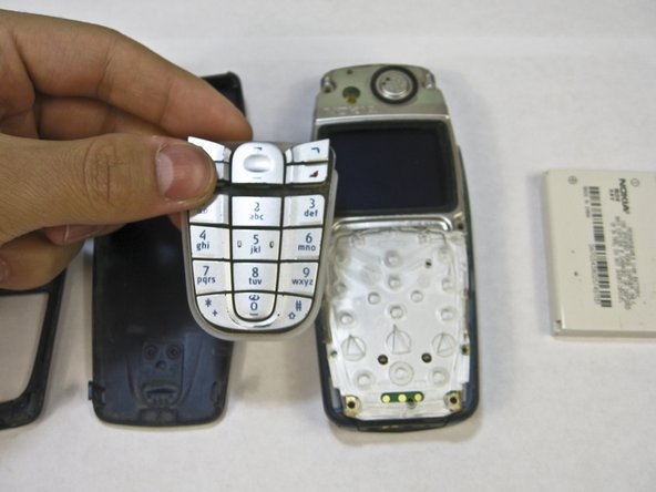 Lift the keypad away from the body of the phone.
