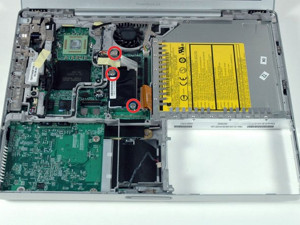 Remove the three Phillips screws securing the modem and modem shield to the logic board.