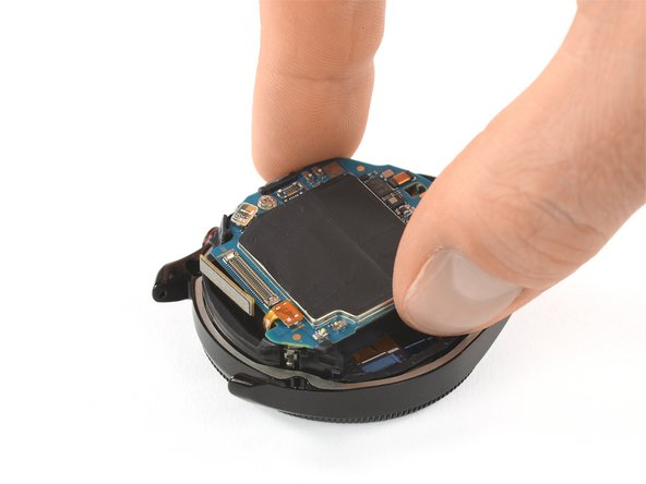 Carefully thread the display flex cable through the gap on the core's plastic frame.