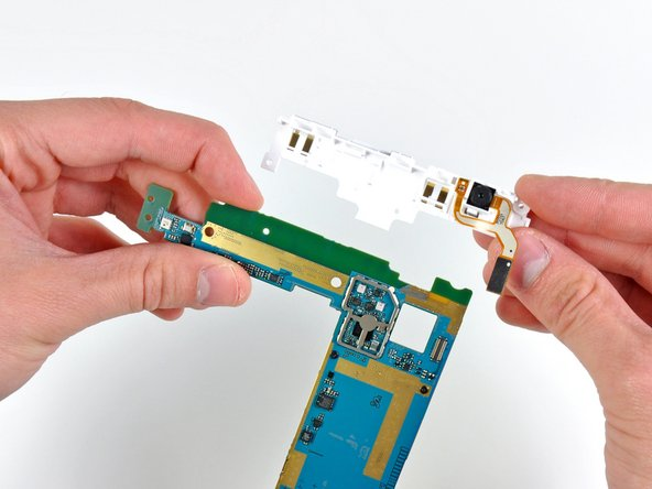 The front facing camera easily separates from the motherboard assembly.