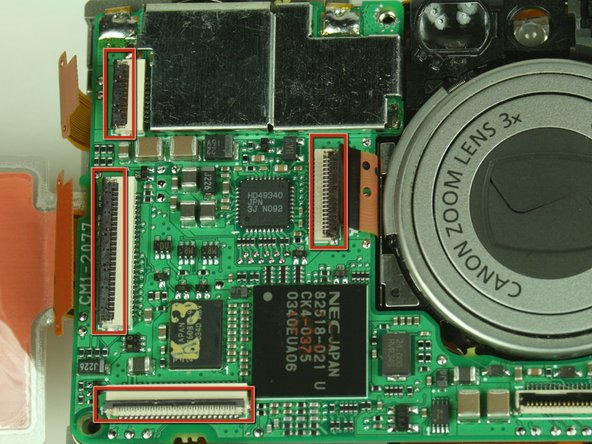 On the main circuit board, gently release the black latches of the four ribbon cables.