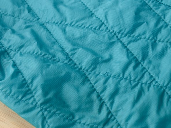 Repairing a Loop of Loose Stitching in a Patagonia Nano Puff ® Jacket