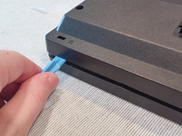 Take the edge tool or a metal ruler and insert it into the bezel.