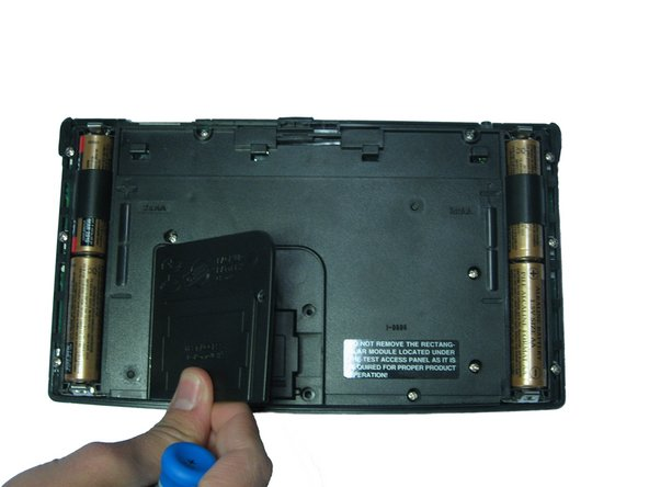 Remove the screw and lift the panel to access battery.
