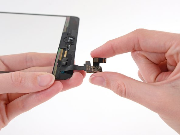Fold the digitizer cable back over onto itself and press firmly to secure the adhesive.