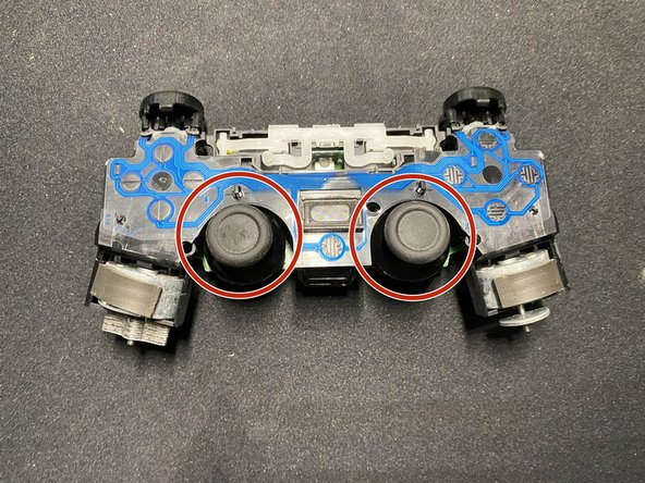Remove the toggle sticks from the controller.