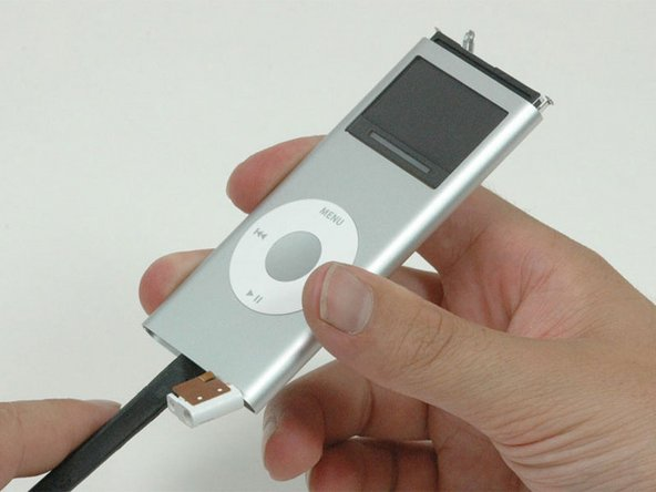 Use a spudger to push the logic board through the iPod out of the casing. The click wheel and headphone jack should remain in the iPod.