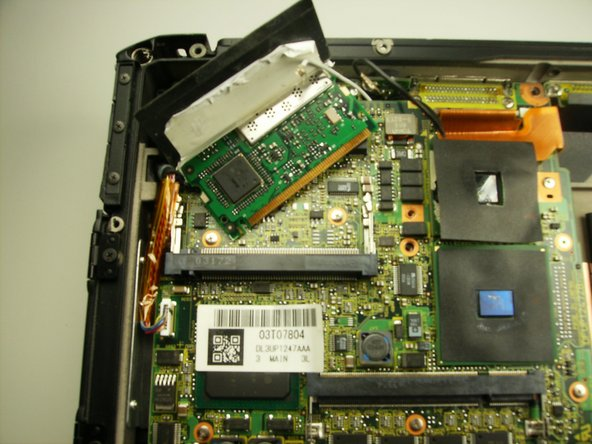 The wireless card should now easily disengage from the motherboard.