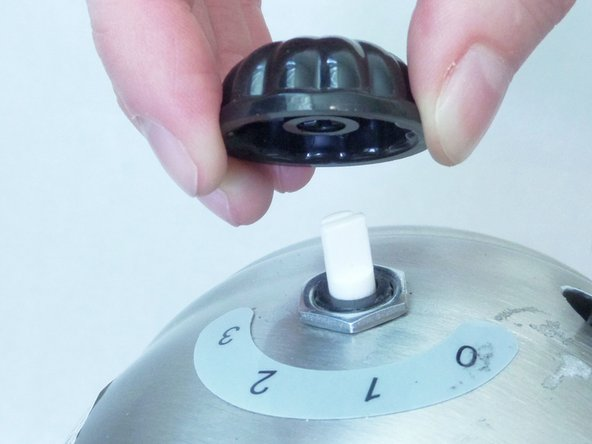 Use your fingers to gently pull the power knob directly away from the motor housing.