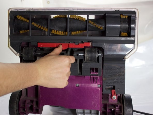 Push the red release lever to the right.