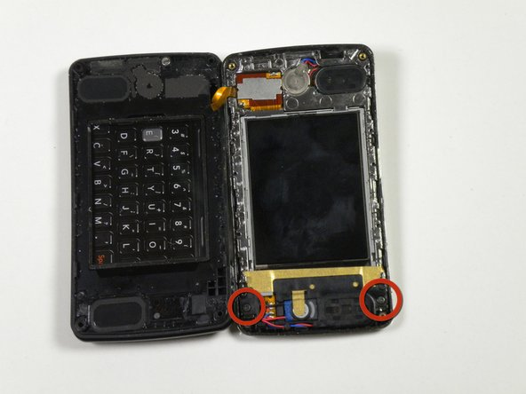 Locate the two 2.5mm screws to the right of the screen (on the photograph shown they are at the bottom).