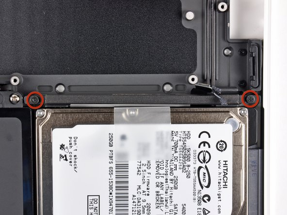Remove the two Phillips screws securing the hard drive bracket to the upper case.