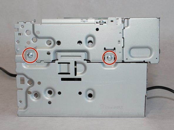 Remove the four 5.5mm screws with the Phillips #1 screwdriver.
