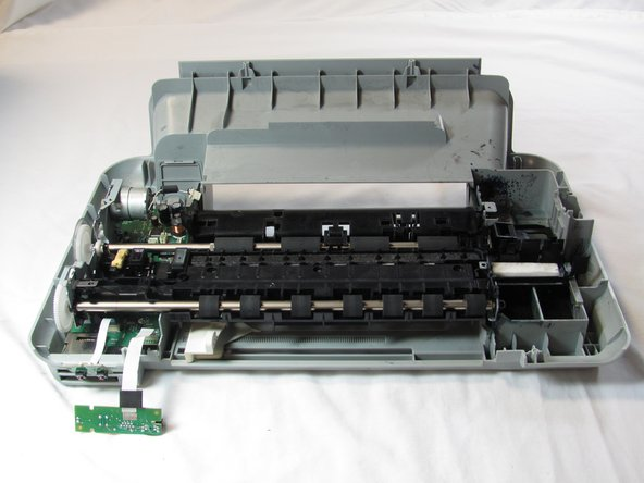 Turn the printer back down so that it is sitting on the bottom panel and rotate the printer 180 degrees.