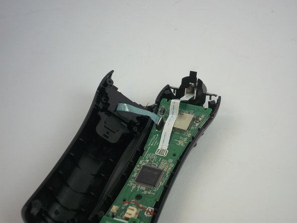 Remove the blue strip that is connected to the trigger button from the motherboard.