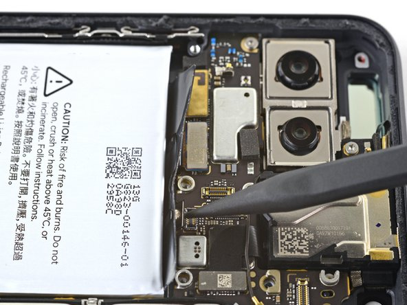 Use the pointed end of a spudger to disconnect the side buttons connector from the motherboard.